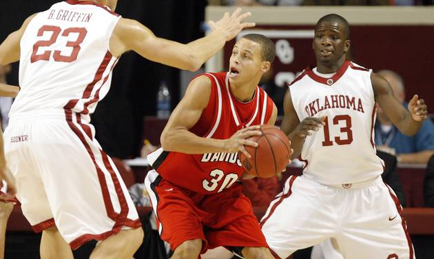 Davidson's Stephen Curry (30) looks for rooom on the baseline against Oklahoma's Blake Griffin (23) and Willie Warren (13) during the first half of the pre season NIT college basketball game between the University of Oklahoma and Davidson University on Tuesday, Nov. 18, 2008 at the Lloyd Noble Center in Norman. By Chris Landsberger